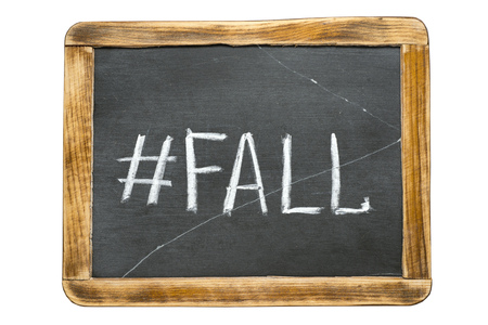 redirect: fall hashtag handwritten on vintage school slate board isolated on white