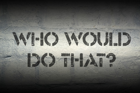 would: who would do that question stencil print on the grunge white brick wall Stock Photo