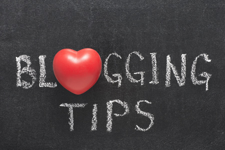 virtual community: blogging tips phrase handwritten on blackboard with heart symbol instead of O Stock Photo