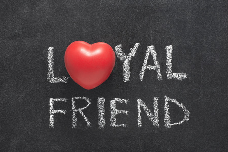 bounds: loyal friend phrase handwritten on blackboard with heart symbol instead of O Stock Photo