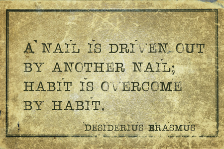driven: A nail is driven out by another nail; habit is overcome - ancient Dutch philosopher Desiderius Erasmus quote printed on grunge vintage cardboard Stock Photo