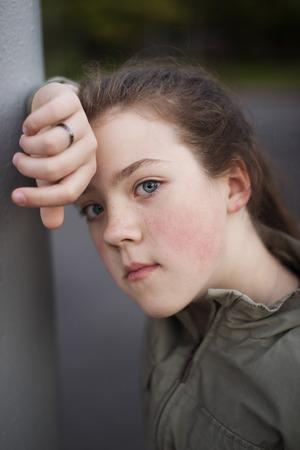 leaned: girl in pensive mood leaned against a pillar