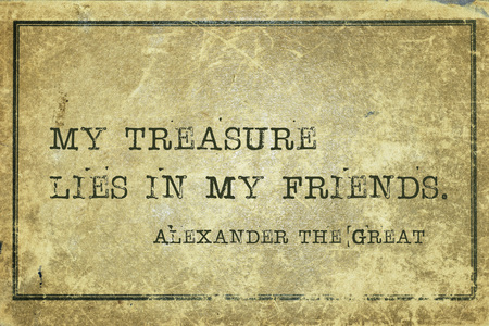 conquer: My treasure lies in my friends - ancient conquer and King of Macedonia Alexander the Great quote printed on grunge vintage cardboard Stock Photo