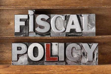 fiscal: fiscal policy phrase made from metallic letterpress type on wooden tray