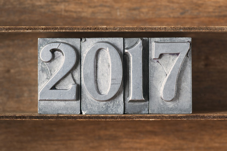letterpress type: 2017 number made from metallic letterpress type on wooden tray