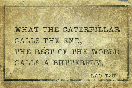 end of the world: What the caterpillar calls the end, the rest of the world calls a butterfly - ancient Chinese philosopher Lao Tzu quote printed on grunge vintage cardboard