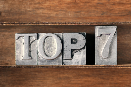 top 7: top 7 phrase made from metallic letterpress type on wooden tray Stock Photo