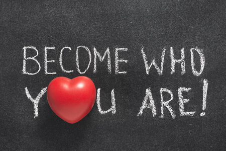 become: become who you are phrase handwritten on blackboard with heart symbol instead of O