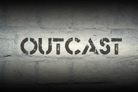 outlaw: outcast word stencil print on the grunge white brick wall Stock Photo