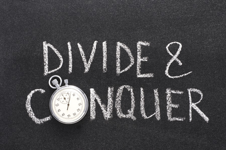 conquer: divide and conquer phrase handwritten on chalkboard with vintage precise stopwatch used instead of O