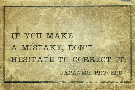 HESITATE: If you make a mistake, dont hesitate to correct - ancient Japanese proverb printed on grunge vintage cardboard