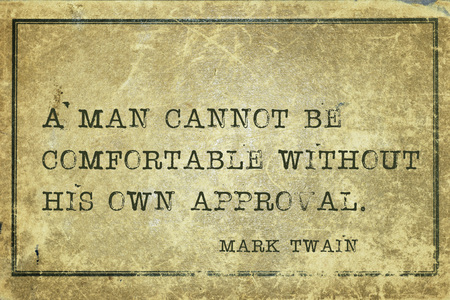 twain: A man cannot be comfortable without his own approval  -  famous American writer Mark Twain quote printed on grunge vintage cardboard
