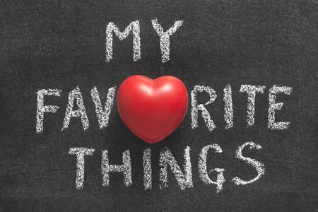 my favorite things phrase handwritten on blackboard with heart symbol instead of O