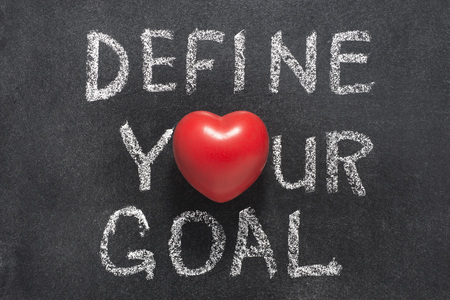 define: define your goal phrase handwritten on blackboard with heart symbol instead of O Stock Photo