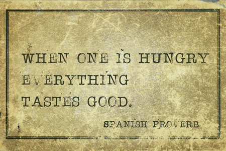 tastes: When one is hungry everything tastes good - ancient Spanish proverb printed on grunge vintage cardboard