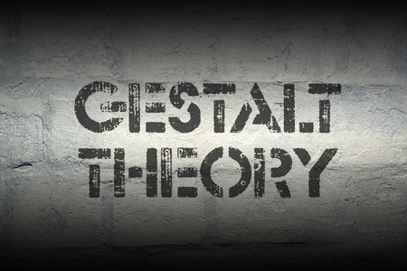 unified: gestalt theory phrase stencil print on the grunge white brick wall Stock Photo