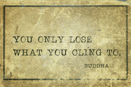 cardboard only: You only lose what you cling to - famous Buddha quote printed on grunge vintage cardboard