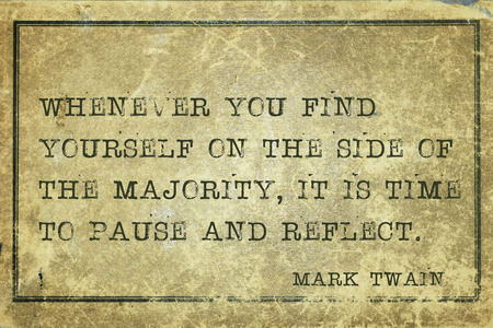 paradox: Whenever you find yourself on the side of the majority, it is time to pause and reflect - famous American writer Mark Twain quote printed on grunge vintage cardboard