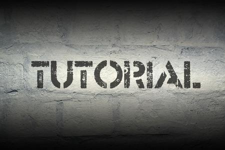 classbook: tutorial word stencil print on the grunge white brick wall