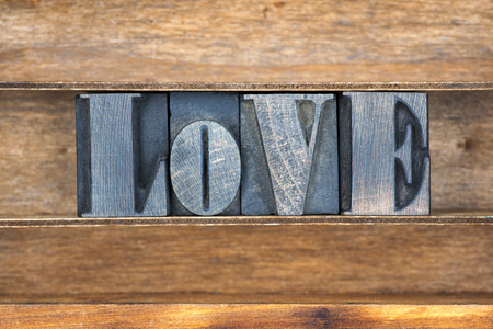 letterpress type: love word made from vintage letterpress type on wooden tray Stock Photo