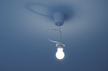 switched: bright switched on light bulb on ceiling