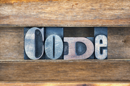 letterpress type: code word made from vintage letterpress type on wooden tray Stock Photo