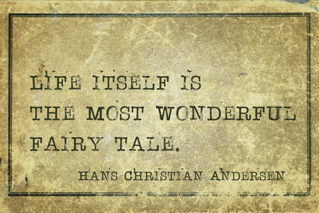 ancient philosophy: Life itself is the most wonderful fairy tale - famous Danish fairy tale writer Hans Christian Andersen quote printed on grunge vintage cardboard Stock Photo