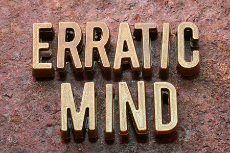 erratic: erratic mind phrase made from metallic letters on red rusty surface