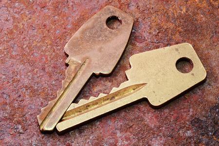 findings: two vintage door keys on old rusty metallic surface