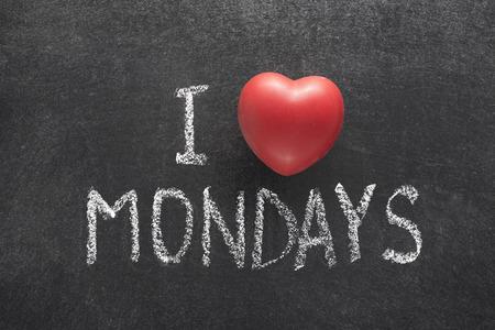I love Mondays phrase handwritten on chalkboard with heart symbol instead of O