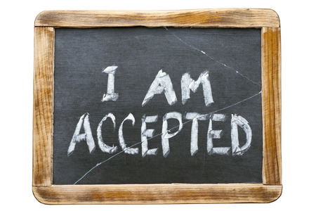 accepted: I am accepted phrase handwritten on vintage school slate board