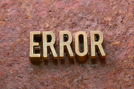 flaw: error word made from metallic letters on red rusty surface