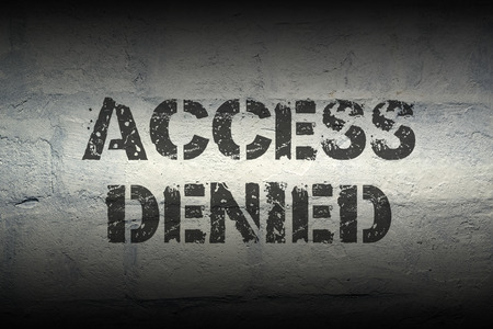 access denied black stencil print on the grunge brick wall Stock Photo - 66080592