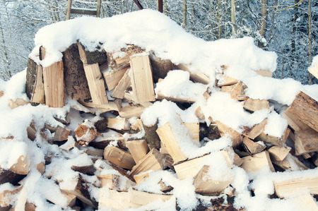 stack of firewood: huge stack of firewood under fresh snow  Stock Photo