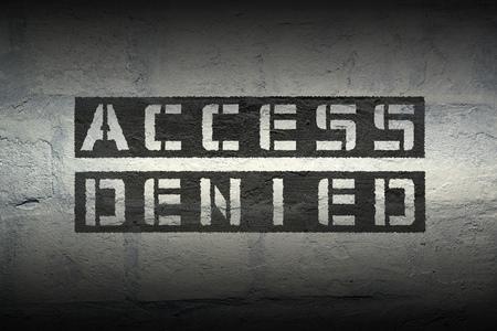 access denied black stencil print on the grunge brick wall