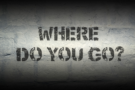 where to go: where do you go question stencil print on the grunge brick wall; specially designed font is used