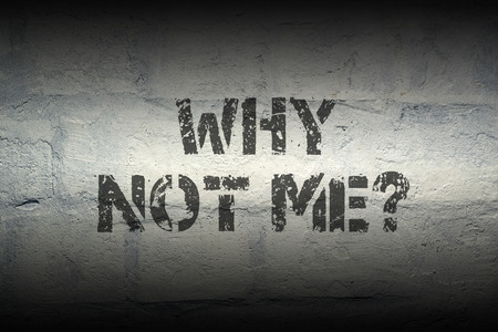 why not me question stencil print on the grunge brick wall; specially designed font is used