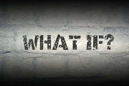 what if: what if question stencil print on the grunge white brick wall; specially designed font is used