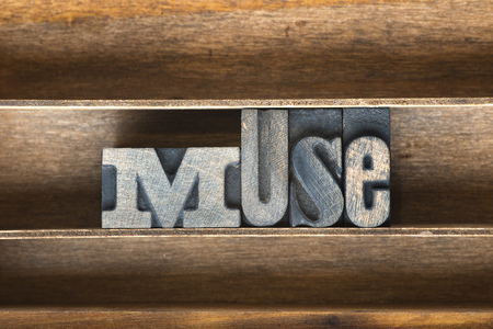 afflatus: muse word made from vintage letterpress type on wooden tray Stock Photo