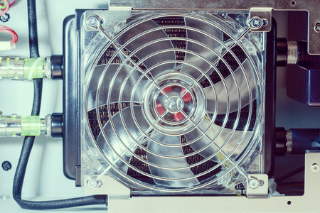 exchanger: cooling fan set on heat exchanger inside industrial system Stock Photo