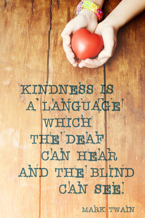 twain: famous Mark Twain  quote about kindness printed over image with red heart in hands Stock Photo