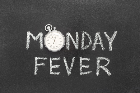 Monday fever phrase handwritten on chalkboard with vintage precise stopwatch used instead of O