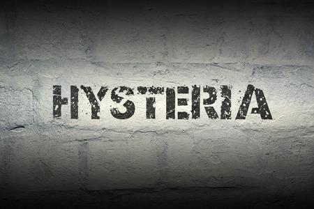 hysteria: hysteria stencil print on the grunge white brick wall