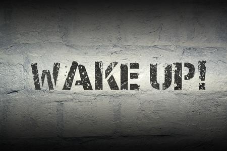 wake up exclamation stencil print on the grunge white brick wall Фото со стока - 66449909