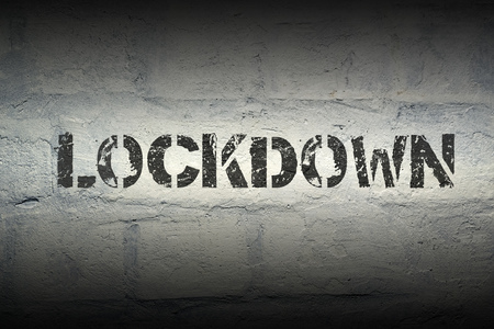 lockdown: lockdown stencil print on the grunge white brick wall