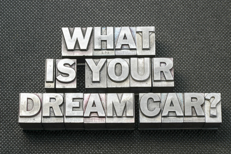 soñar carro: what is your dream car question made from metallic letterpress blocks on black perforated surface
