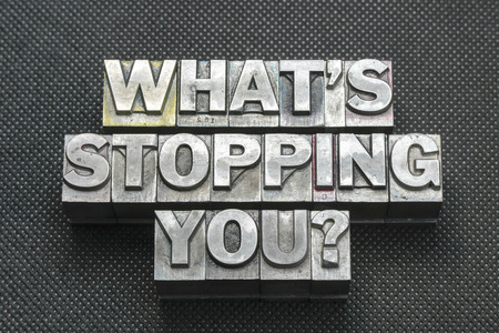 letterpress blocks: what stopping you phrase made from metallic letterpress blocks on black perforated surface