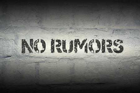 no rumors stencil print on the grunge white brick wall