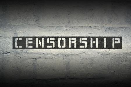 censorship stencil print on the grunge white brick wall