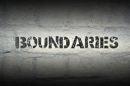 boundaries: boundaries stencil print on the grunge white brick wall Stock Photo